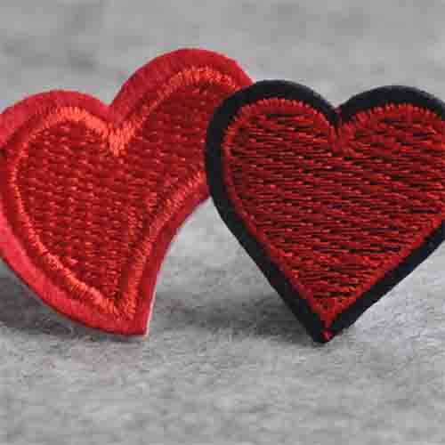 red heart-shaped stitching ornament for bag and shoe