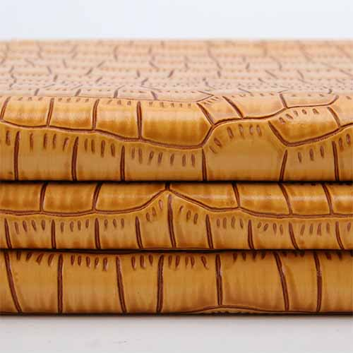pu leather resembling crocodile skin pattern
